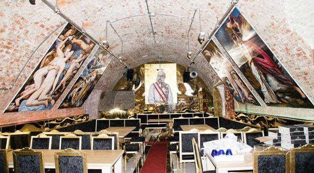 The underground establishment is lined with gigantic oil paintings hanging from the ceiling. Source: Vice