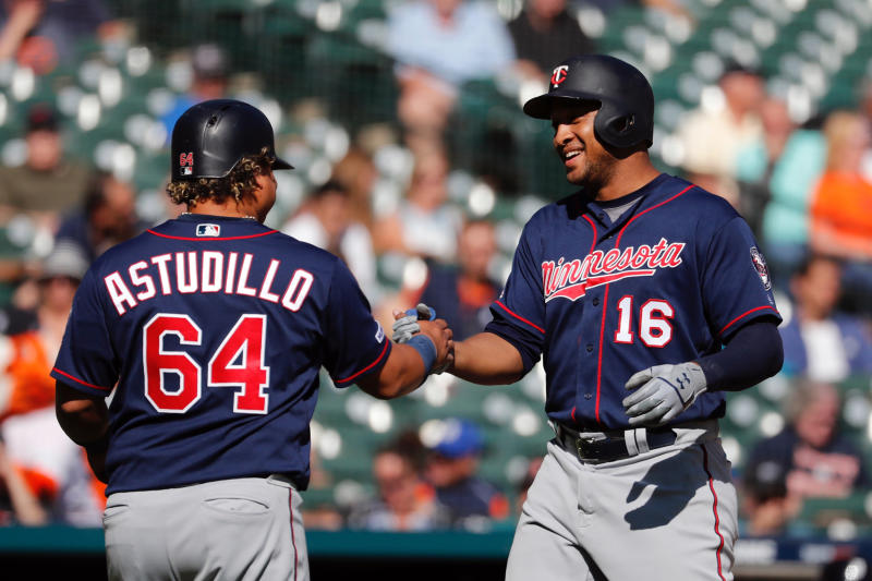 Minnesota Twins designated hitter Jonathan Schoop (16) receives congratulations from third baseman Willians Astudillo (64) after he hits a two run home run in the seventh inning against the Detroit Tigers at Comerica Park. (Rick Osentoski-USA TODAY Sports)