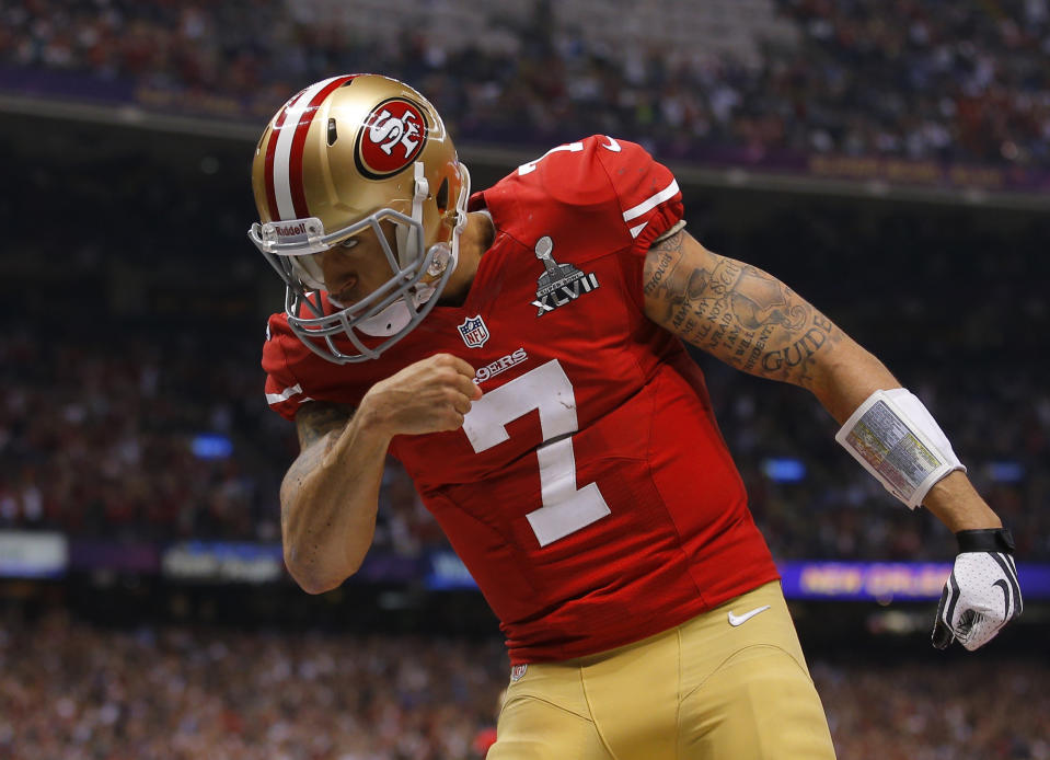 San Francisco 49ers quarterback Colin Kaepernick (7) celebrates his fourth quarter touchdown against the Baltimore Ravens in the NFL Super Bowl XLVII football game in New Orleans, Louisiana, February 3, 2013.   REUTERS/Brian Snyder (UNITED STATES  - Tags: SPORT FOOTBALL)