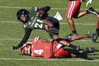 Hawaii defensive back Michael Washington (21) is tackled by Houston wide receiver Nathaniel Dell (4) after an interception during the first quarter of the New Mexico Bowl NCAA college football game in Frisco, Texas, Thursday, Dec. 24, 2020. (AP Photo/Matt Strasen)
