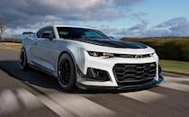 "<p>With a fire-breathing 650-hp supercharged V-8 and ferocious track capabilities, the <a href=""https://www.caranddriver.com/chevrolet/camaro-zl1"" rel=""nofollow noopener"" target=""_blank"" data-ylk=""slk:2021 Chevy Camaro ZL1"" class=""link rapid-noclick-resp"">2021 Chevy Camaro ZL1</a> is the king of monster muscle cars. Sure, the <a href=""https://www.caranddriver.com/dodge/challenger-srt-srt-hellcat"" rel=""nofollow noopener"" target=""_blank"" data-ylk=""slk:Dodge Challenger SRT Hellcat"" class=""link rapid-noclick-resp"">Dodge Challenger SRT Hellcat</a> and <a href=""https://www.caranddriver.com/ford/mustang-shelby-gt500"" rel=""nofollow noopener"" target=""_blank"" data-ylk=""slk:Ford Mustang Shelby GT500"" class=""link rapid-noclick-resp"">Ford Mustang Shelby GT500</a> have horsepower ratings that start with seven, but the bow-tie beast delivers similar thrills for fewer green bills. In fact, if the <a href=""https://www.caranddriver.com/chevrolet/corvette"" rel=""nofollow noopener"" target=""_blank"" data-ylk=""slk:mid-engine Corvette"" class=""link rapid-noclick-resp"">mid-engine Corvette</a> didn't exist, the ZL1 could perhaps be called the world's greatest performance value. Regardless, the Camaro perfects the front-engine, rear-drive formula inherent to muscle cars. While both the coupe and convertible have a remarkable chassis that's more clairvoyant than Miss Cleo, unleashing the ultimate Camaro requires the transformative 1LE track package, but beware that it makes the suspension very stiff. If you can overlook the Chevy's flawed interior, the 2021 Camaro ZL1 can be more exciting than a roller coaster, and it'll regularly reward thrill-seekers and track rats alike.</p><p><a class=""link rapid-noclick-resp"" href=""https://www.caranddriver.com/chevrolet/camaro-zl1"" rel=""nofollow noopener"" target=""_blank"" data-ylk=""slk:Review, Pricing, and Specs"">Review, Pricing, and Specs</a></p>"