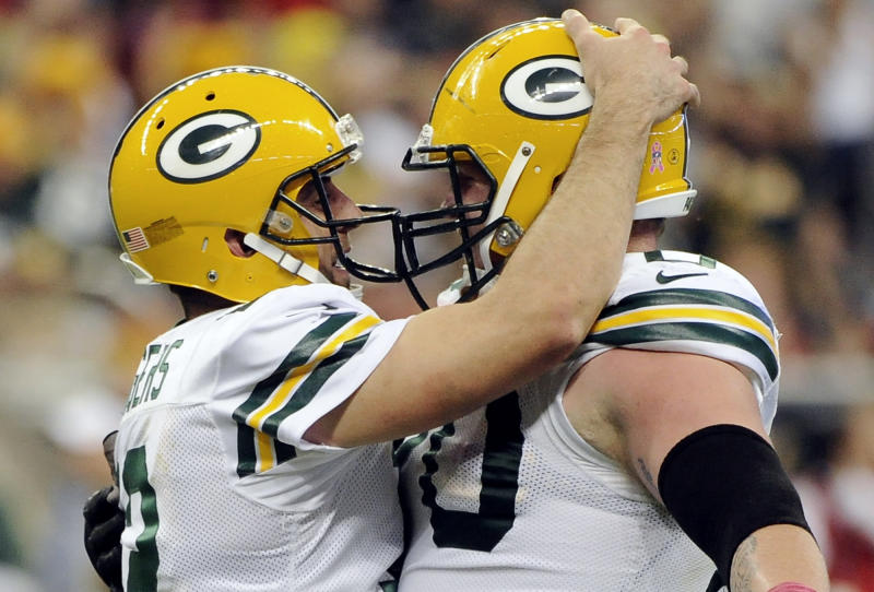 Green Bay Packers quarterback Aaron Rodgers (12) and guard T.J. Lang (70) celebrate a touchdown against the Houston Texans in the fourth quarter of an NFL football game, Sunday, Oct. 14, 2012, in Houston. (AP Photo/Dave Einsel)