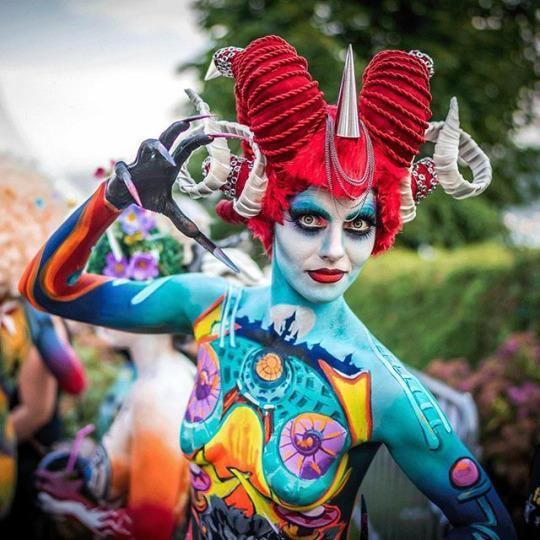 """<p>A contestant with bright red horns shows off her long claws and detailed bodypainting. (Source: <a href=""""https://instagram.com/p/43MU9WMv7e/"""" rel=""""nofollow noopener"""" target=""""_blank"""" data-ylk=""""slk:Instagram, pege78"""" class=""""link rapid-noclick-resp"""">Instagram, pege78</a>)</p>"""
