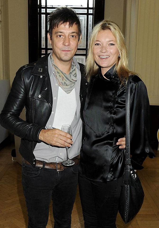 Sorry, Jamie Hince! When Kate Moss gets married, no one really cares about anything but what she's wearing! The fashionable model donned a retro, glittery gown created just for her by controversial designer John Galliano as she wed The Kills rocker in Southrop, England, on July 1. Stella McCartney also designed several outfits for her to wear during a weekend of events to celebrate the marriage, including a party dress with a cut-out back and a wool three-piece ensemble. In case anyone cares, he wore a suit.