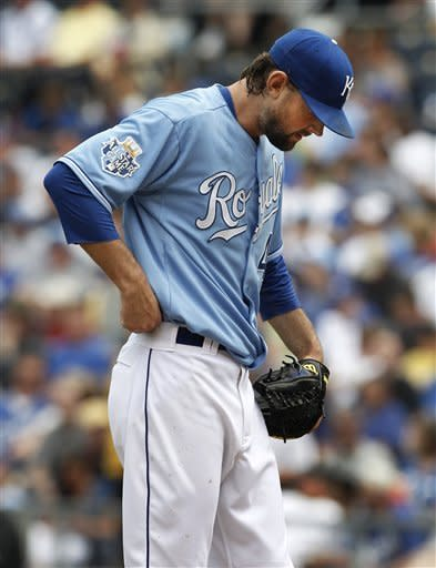 Kansas City Royals starting pitcher Luke Hochevar waits for the next batter after giving up a grand slam to New York Yankees' Robinson Cano during the third inning of a baseball game in Kansas City, Mo., Sunday, May 6, 2012. (AP Photo/Orlin Wagner)