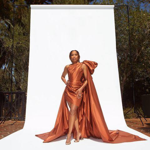 """<p>Proving that a virtual red carpet can be just as dramatic as the old-fashioned type was Regina King, who posed in a beautiful one-shouldered Oscar de la Renta gown which featured a giant bow, a long train and a short hem at the front.</p><p><a href=""""https://www.instagram.com/p/CM8OvEcnPAS/?utm_source=ig_embed&utm_campaign=loading"""" rel=""""nofollow noopener"""" target=""""_blank"""" data-ylk=""""slk:See the original post on Instagram"""" class=""""link rapid-noclick-resp"""">See the original post on Instagram</a></p>"""