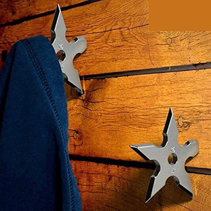 <p>These <span>cool-looking ninja dart coat hooks</span> ($10) will keep his coats, hats, and scarves off the floor. </p>