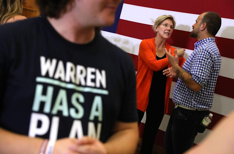 SIOUX CITY, IOWA - JULY 19: (L-R) O. Kay Henderson, news director for Radio Iowa and Kathie Obradovich, the opinion editor and columnist for the Des Moines Register, look on as democratic presidential hopeful U.S. Sen. Elizabeth Warren (D-MA) speaks during the AARP and The Des Moines Register Iowa Presidential Candidate Forum on July 19, 2019 in Sioux City, Iowa. Twenty democratic presidential hopefuls are participating in the AARP and Des Moines Register candidate forums that will feature four candidates per forum that are being to be held in cities across Iowa over five days. (Photo by Justin Sullivan/Getty Images)