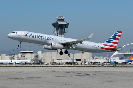 An American Airlines Airbus A321 plane takes off from Los Angeles International airport