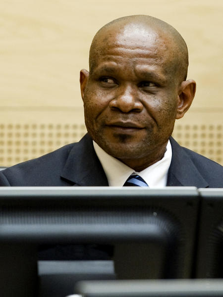 Former leader of the National Integrationist Front Mathieu Ngudjolo awaits his verdict at the International Criminal Court (ICC) in The Hague, Netherlands, Tuesday, Dec. 18, 2012. The ICC acquitted Ngudjolo of all charges of leading fighters who destroyed a strategic village in eastern Congo, hacking to death and raping some 200 people including women and children in 2003. Tuesday's acquittal is only the second verdict in the court's 10-year history and the first time it has cleared a suspect. (AP Photo/Robin van Lonkhuijsen, Pool)