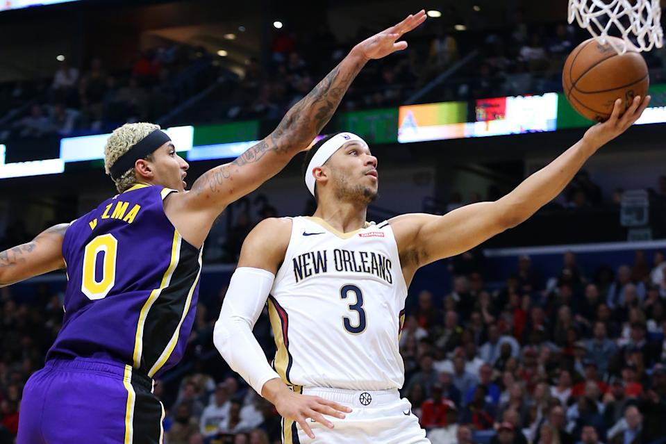 NEW ORLEANS, LOUISIANA - MARCH 01: Josh Hart #3 of the New Orleans Pelicans shoots against Kyle Kuzma #0 of the Los Angeles Lakers during the first half at the Smoothie King Center on March 01, 2020 in New Orleans, Louisiana. NOTE TO USER: User expressly acknowledges and agrees that, by downloading and or using this Photograph, user is consenting to the terms and conditions of the Getty Images License Agreement. (Photo by Jonathan Bachman/Getty Images)