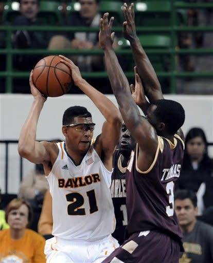 Baylor's Isaiah Austin (21) is defended by College of Charleston Anthony Thomas (3) and Adjehi Baru (1) in the first half of an NCAA college basketball game, Saturday Nov. 24, 2012 in Waco, Texas. (AP Photo/Waco Tribune Herald, Rod Aydelotte)