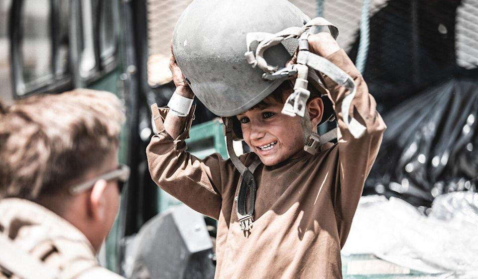 A US marine plays with a child at Hamid Karzai International Airport in Kabul during the evacuation of civilians. Photo: US Marines via ZUMA Press Wire Service/dpa