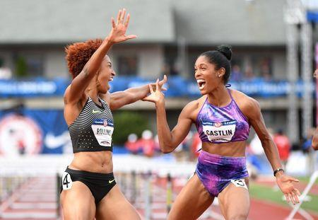 Jul 8, 2016; Eugene, OR, USA; Brianna Rollins (left) and Kristi Castlin (right) react after competing during the women's 100m hurdles finals in the 2016 U.S. Olympic track and field team trials at Hayward Field. Mandatory Credit: James Lang-USA TODAY Sports