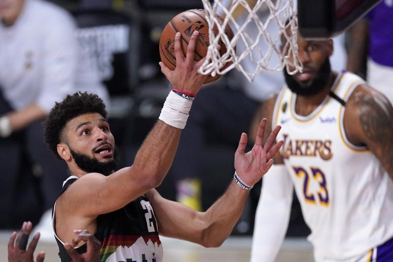 Denver Nuggets guard Jamal Murray, left, goes up for a shot attempt as Los Angeles Lakers' LeBron James, right rear, looks on during the second half of Game 3 of the NBA basketball Western Conference final Tuesday, Sept. 22, 2020, in Lake Buena Vista, Fla. (AP Photo/Mark J. Terrill)