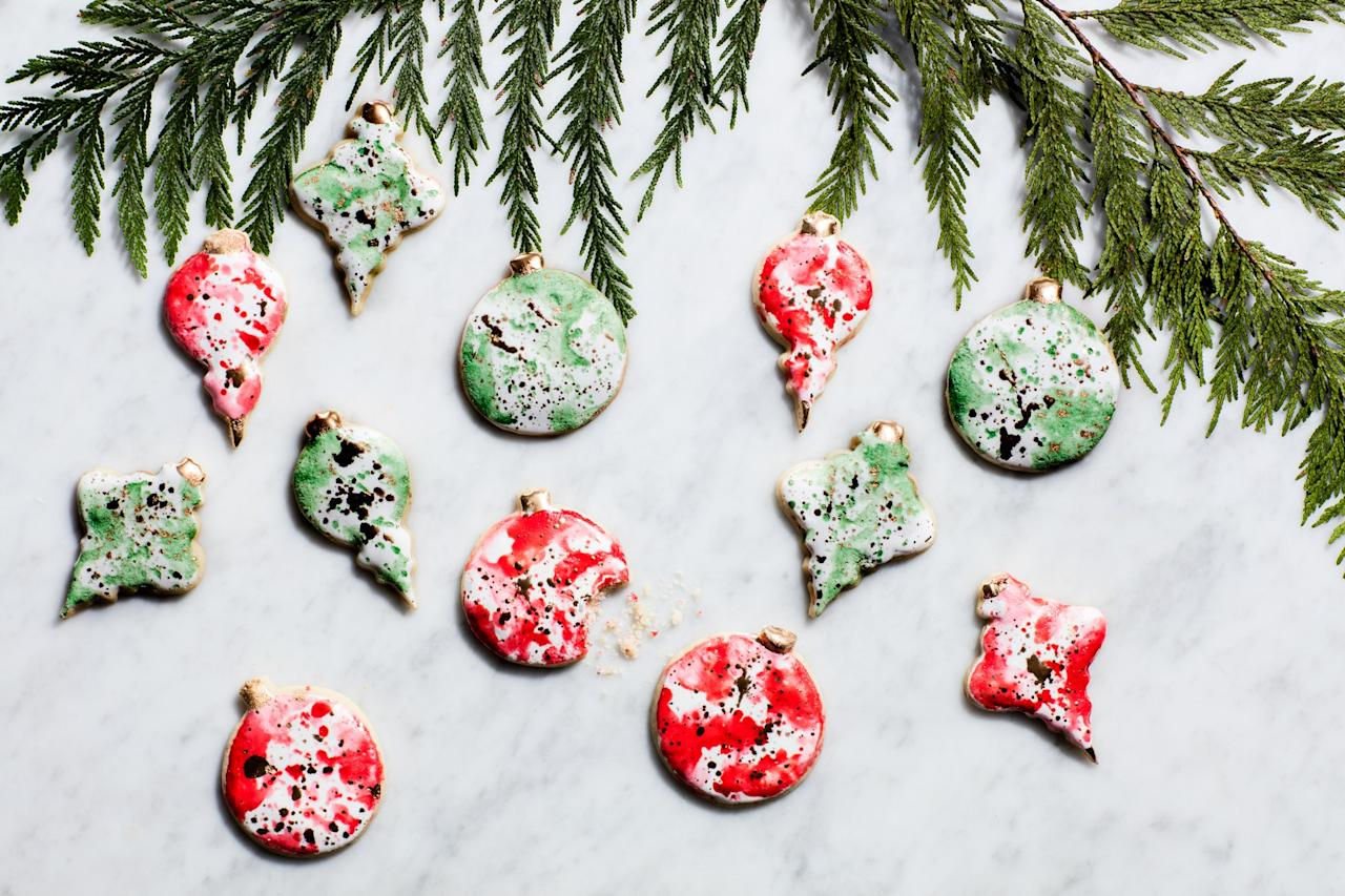 "Using a simple watercolor painting technique, it's easy to brush and splatter these cookies with unique patterns that will really stand out on any holiday dessert table. <a href=""https://www.epicurious.com/recipes/food/views/watercolor-christmas-ornament-cookies?mbid=synd_yahoo_rss"">See recipe.</a>"