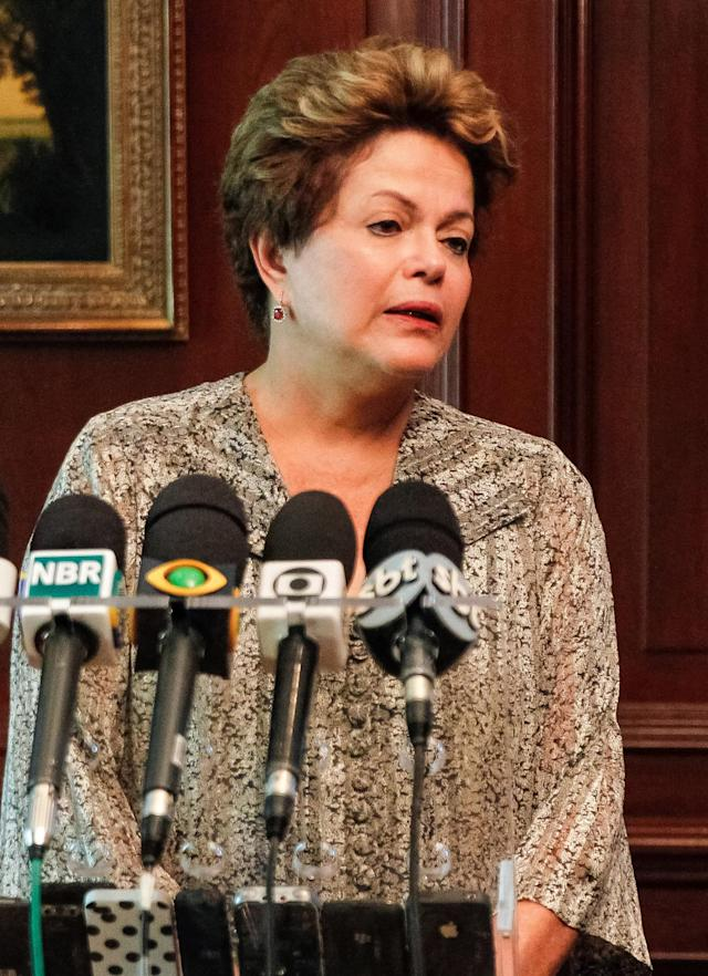 In this photo released by Brazil's Presidency, Brazil's President Dilma Rousseff, left, speaks about a fire that swept through a crowded nightclub killing at least 245 people i a southern Brazil, during a press conference in Santiago, Chile, Sunday, Jan. 27, 2013. Rousseff cut short a visit to Chile early Sunday to return home after the deadly nightclub fire. The fire killed at least 245 people and left at least 200 injured, police and firefighters said. (AP Photo/Brazil's Presidency)