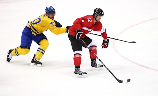 SOCHI, RUSSIA - FEBRUARY 23: Alexander Steen #20 of Sweden challenges Jamie Benn #22 of Canada for the puck during the Men's Ice Hockey Gold Medal match on Day 16 of the 2014 Sochi Winter Olympics at Bolshoy Ice Dome on February 23, 2014 in Sochi, Russia. (Photo by Streeter Lecka/Getty Images)