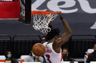 Toronto Raptors forward OG Anunoby dunks during the first quarter of the team's NBA basketball game agains the Sacramento Kings 5in Sacramento, Calif., Friday, Jan. 8, 2021. (AP Photo/Rich Pedroncelli)