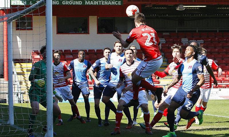 Crewe's Ryan Wintle gets up at the back post to head in the second goal of the game against Leyton Orient at the Alexandra Stadium.