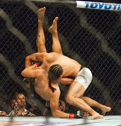Sage Northcutt (R) takes down Francisco Trevino during their UFC 192 fight. (AP)