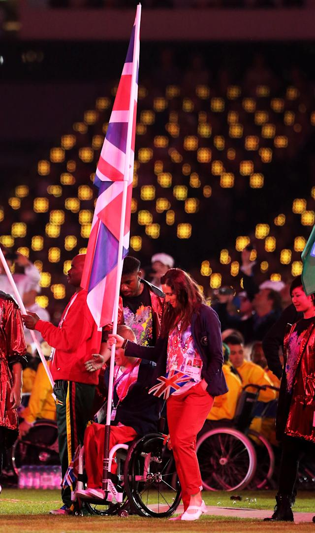 LONDON, ENGLAND - SEPTEMBER 09: Athlete David Weir and cyclist Sarah Storey of Great Britain carry the flag join fellow flagbearers during the closing ceremony on day 11 of the London 2012 Paralympic Games at Olympic Stadium on September 9, 2012 in London, England. (Photo by Peter Macdiarmid/Getty Images)