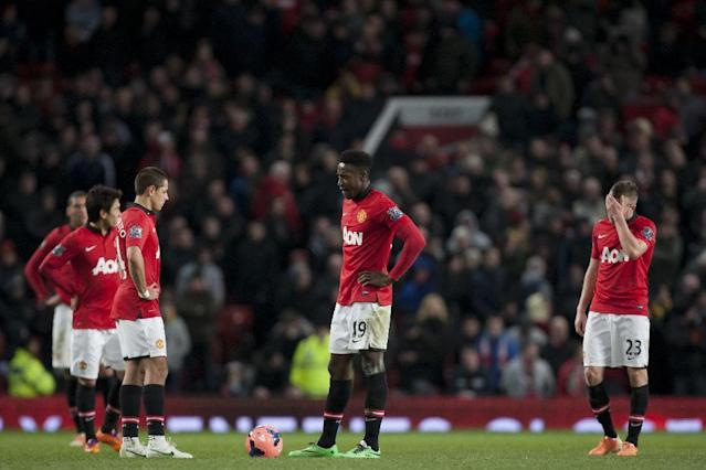 Manchester United's Danny Welbeck, centre, waits with teammates for play to restart after Swansea City's second goal during their English FA Cup third round soccer match at Old Trafford Stadium, Manchester, England, Sunday Jan. 5, 2014. Swansea City won the game 2-1. (AP Photo/Jon Super)