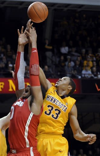 Minnesota's Rodney Williams (33) rebounds over Ohio State's Jared Sullinger (0) in the second half during an NCAA college basketball game in Minneapolis on Tuesday, Feb. 14, 2012. (AP Photo/Hannah Foslien)