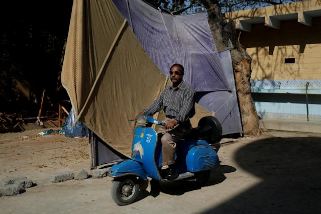 "<p>Journalist Nazeer Udding Siddiqui, 58, poses for a photograph with his 1979 model Vespa scooter in Karachi, Pakistan March 6, 2018. ""My father used to work for Khwaja Auto as a manager and they were the only distributers of Vespa scooters. For me, people who own Vespas are very honourable people who still keep this tradition alive,"" Siddiqui said. (Photo: Akhtar Soomro/Reuters) </p>"
