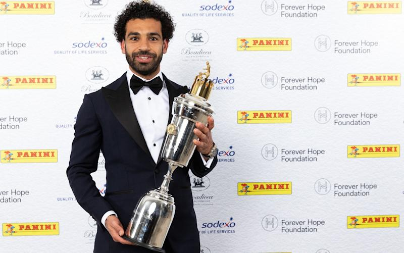 Mohamed Salah shows off his trophy after being named PFA Player of the Year on Sunday night  - PA