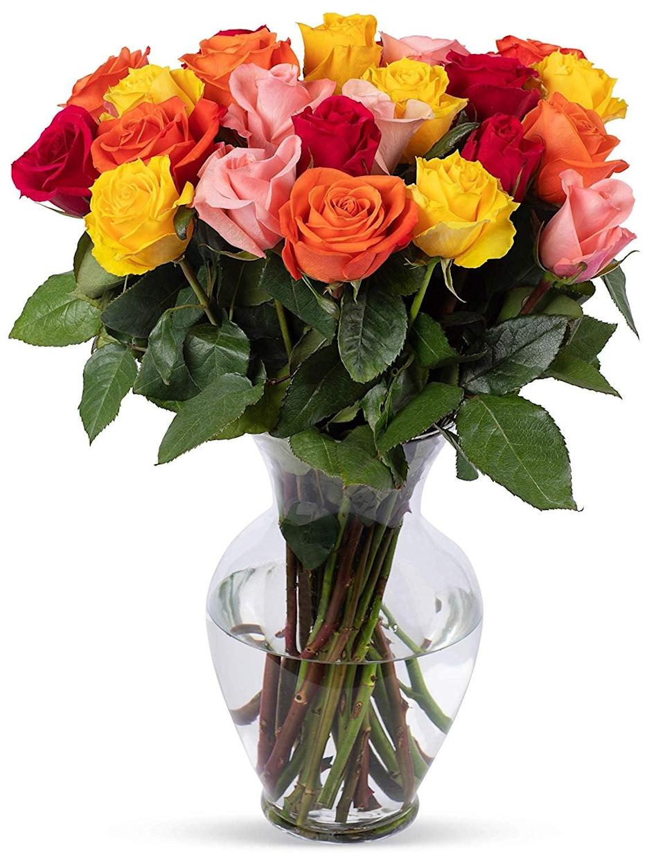 """<p>Warm up your loved one's home with these <a href=""""https://www.popsugar.com/buy/Benchmark-Bouquets-Rainbow-Roses-444294?p_name=Benchmark%20Bouquets%20Rainbow%20Roses&retailer=amazon.com&pid=444294&price=53&evar1=casa%3Aus&evar9=46127505&evar98=https%3A%2F%2Fwww.popsugar.com%2Fhome%2Fphoto-gallery%2F46127505%2Fimage%2F46128472%2FBenchmark-Bouquets-Rainbow-Roses&list1=shopping%2Cgift%20guide%2Cflowers%2Chouse%20plants%2Cplants%2Cmothers%20day%2Cgifts%20for%20women&prop13=api&pdata=1"""" class=""""link rapid-noclick-resp"""" rel=""""nofollow noopener"""" target=""""_blank"""" data-ylk=""""slk:Benchmark Bouquets Rainbow Roses"""">Benchmark Bouquets Rainbow Roses</a> ($53).</p>"""