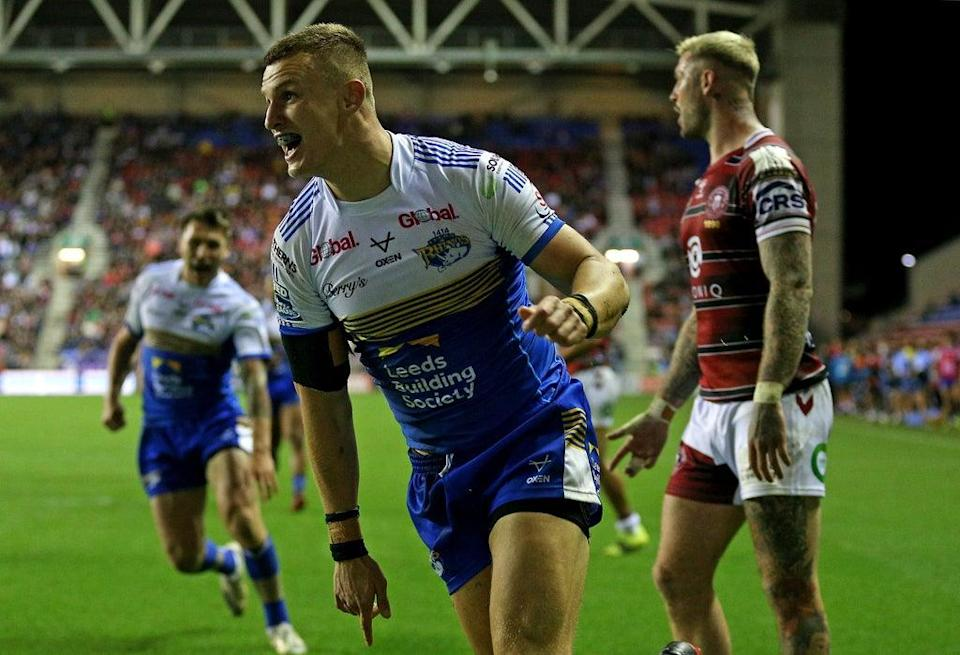 Ash Handley celebrates after scoring Leeds' try (Nigel French/PA) (PA Wire)