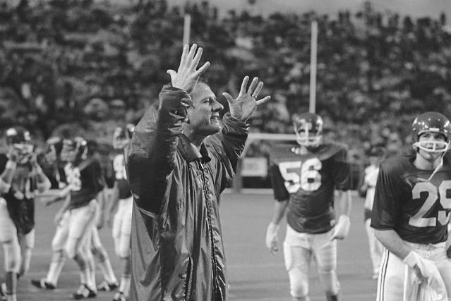 FILE - In this Oct. 18, 1971, file photo, Arkansas football coach Frank Broyles reacts to the Razorback's 31-7 victory over the Texas Longhorns in an NCAA college football game in Little Rock, Ark. While his pace has slowed somewhat over the years, Broyles has remained a fixture at Arkansas football and basketball games and has worked promoting the university and state he adopted as his own when he first arrived prior to the 1958 football season. (AP Photo/Ferd Kaufman, File)