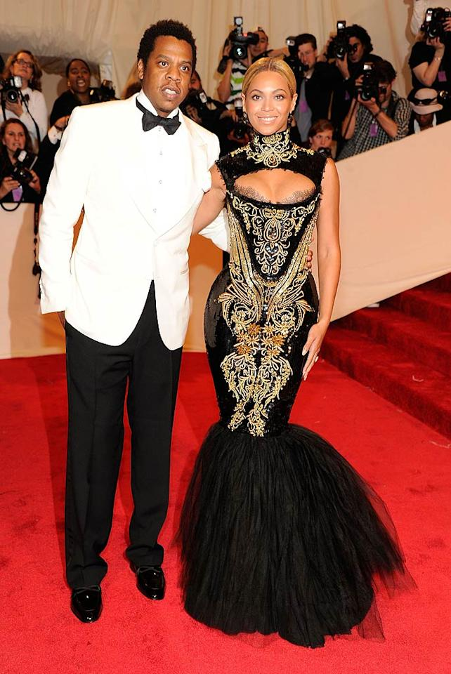 "Jay-Z kept it classic with a white tuxedo jacket, while wife Beyonce showed off a super-tight fishtail Emilio Pucci dress. The A-list couple got booed by the crowd, but they should take it as a compliment. Fans wanted them to stay on the red carpet longer! Kevin Mazur/<a href=""http://www.wireimage.com"" target=""new"">WireImage.com</a> - May 2, 2011"