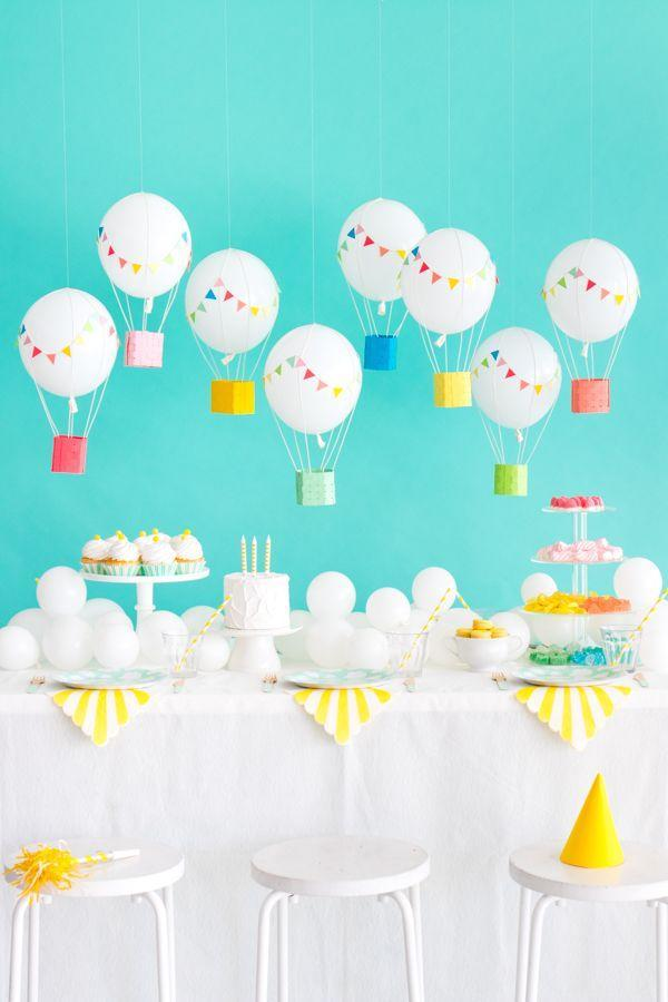 """<p>Turn regular balloons into mini hot air balloons with the assistance of cardstock, twine, and small wire hooks. </p><p><strong><em><a href=""""https://ohhappyday.com/2017/07/hanging-hot-air-balloons/"""" rel=""""nofollow noopener"""" target=""""_blank"""" data-ylk=""""slk:Get the tutorial at Oh Happy Day"""" class=""""link rapid-noclick-resp"""">Get the tutorial at Oh Happy Day</a>. </em></strong></p><p><a class=""""link rapid-noclick-resp"""" href=""""https://www.amazon.com/Command-Hooks-Small-28-Hooks-17067-MPES/dp/B018IZAL16?tag=syn-yahoo-20&ascsubtag=%5Bartid%7C10070.g.37055923%5Bsrc%7Cyahoo-us"""" rel=""""nofollow noopener"""" target=""""_blank"""" data-ylk=""""slk:SHOP WIRE HOOKS"""">SHOP WIRE HOOKS</a></p>"""