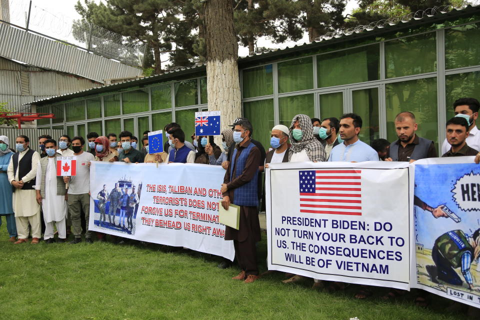 In this Friday, April 30, 2021, photo former Afghan interpreters hold placards during a protest against the U.S. government and NATO in Kabul, Afghanistan. (AP Photo/Mariam Zuhaib)