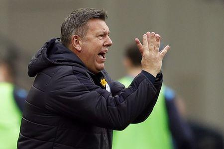 Leicester City manager Craig Shakespeare gestures to his players