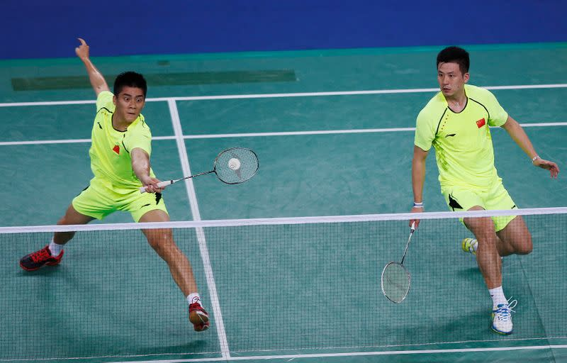 China's Fu Haifeng and Cai Yun return a shot by South Korea during the men's team gold medal badminton match at the Gyeyang Gymnasium during the 17th Asian Games in Incheon