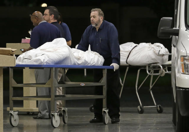 <p>Two bodies of victims arrive at the Orlando Medical Examiner's Office, Sunday, June 12, 2016, in Orlando, Fla. (AP Photo/Alan Diaz) </p>