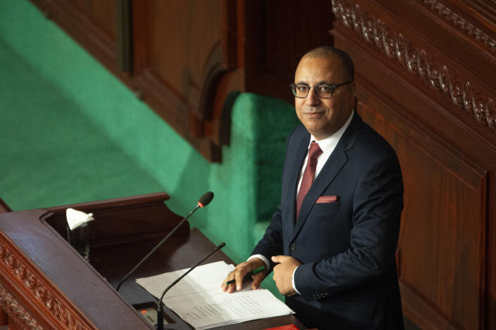 Tunisian designated Prime Minister Hichem Mechichi delivers his speech at the parliament before a confidence vote in Tunis, Tuesday, Sept. 1, 2020. (AP Photo/Riadh Dridi)