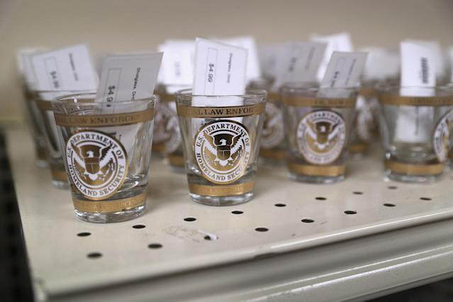 <p>Shot glasses await sale in a souvenir shop at the Federal Law Enforcement Training Center on August 2, 2017 in Artesia, N.M. (Photo: John Moore/Getty Images) </p>