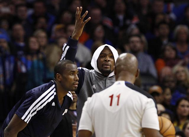 Oklahoma City Thunder's Kevin Durant (35) reacts to an official's call against his team during the second quarter of an NBA basketball game against the Golden State Warriors on Friday, Jan. 17, 2014, in Oklahoma City. (AP Photo/Alonzo Adams)