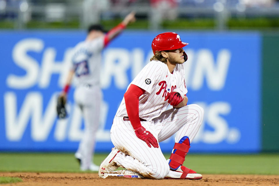 Philadelphia Phillies' Alec Bohm, right, reacts after getting tagged out while trying to stretch a single during the sixth inning of baseball game against the Miami Marlins, Tuesday, May 18, 2021, in Philadelphia. (AP Photo/Matt Slocum)