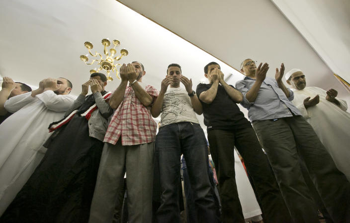 Members of a Muslim congregation pray during a Jumu'ah prayer service at the Islamic Society of Bay Ridge mosque on Friday, Aug. 16, 2013 in the Brooklyn borough of New York. The New York Police Department targeted this mosque as a part of a terrorism enterprise investigation beginning in 2003, spying on it for years. The mosque has never been charged as part of a terrorism conspiracy. (AP Photo/Bebeto Matthews)