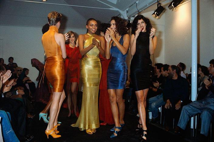 <p>A group of models applaud designer Azzedine Alaïa at his spring 1986 fashion show. </p>