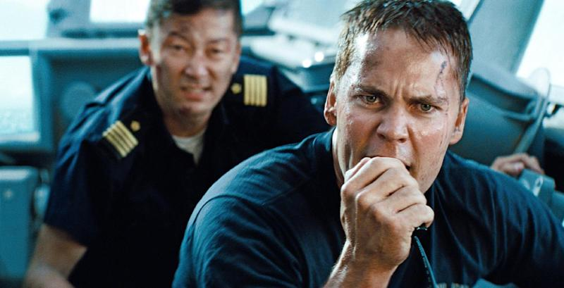 """FILE - This film publicity image released by Universal Pictures shows Tadanobu Asano, left, and Taylor Kitsch in a scene from """"Battleship."""" Studio executives expected their biggest summer ever this year. What they got were two colossal hits (""""The Avengers"""" and """"The Dark Knight Rises""""), a solid slate of back-up blockbusters (among them """"The Amazing Spider-Man"""" and """"Ted"""") and plenty of duds (""""Battleship,"""" """"Total Recall"""") that just didn't deliver. (AP Photo/Universal Pictures, File)"""