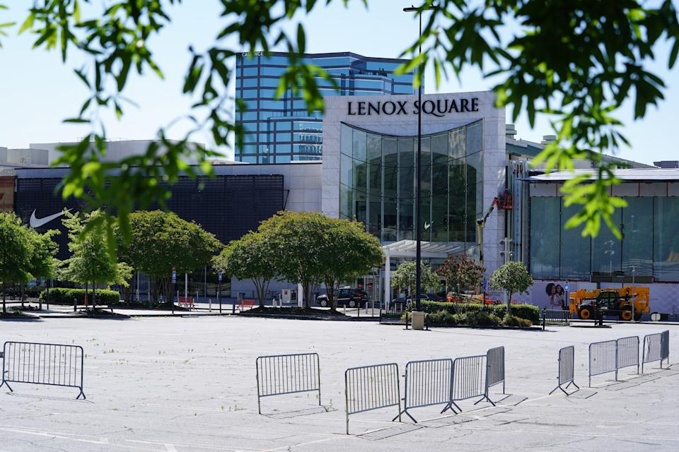 Security barricades stand outside the Lenox Square mall while it remains temporarily closed in Atlanta, Georgia, U.S., on Friday, May 1, 2020. (Elijah Nouvelage/Bloomberg via Getty Images)