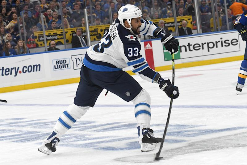 ST. LOUIS, MO - APRIL 16: Winnipeg Jets defenseman Dustin Byfuglien (33) passes the puck during a first round Stanley Cup Playoffs game between the Winnipeg Jets and the St. Louis Blues, on April 16, 2019, at Enterprise Center, St. Louis, Mo. (Photo by Keith Gillett/Icon Sportswire via Getty Images)
