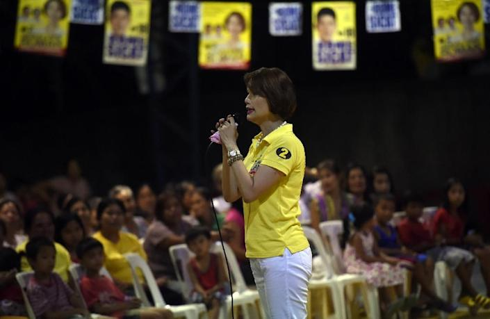 Despite the focus on her gender, Geraldine Roman said her priority was the people of Bataan, and to help more poor students nationwide get scholarships (AFP Photo/Ted Aljibe)