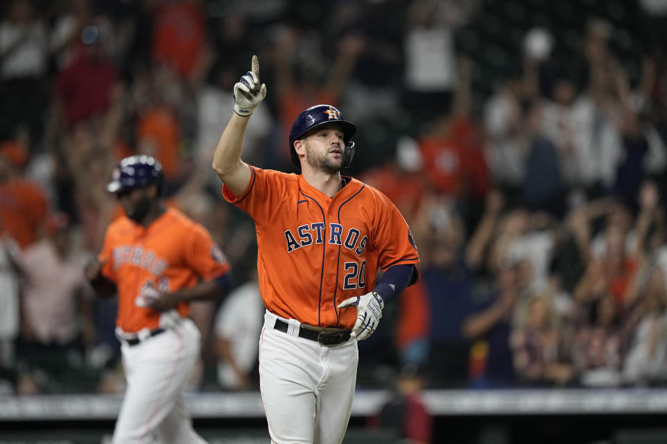 Houston Astros' Chas McCormick (20) celebrates as Yordan Alvarez, rear, scores the game-winning run after McCormick was hit with a pitch with the bases loaded during the 10th inning of a baseball game against the Arizona Diamondbacks Friday, Sept. 17, 2021, in Houston. The Astros won 4-3 in 10 innings. (AP Photo/David J. Phillip)